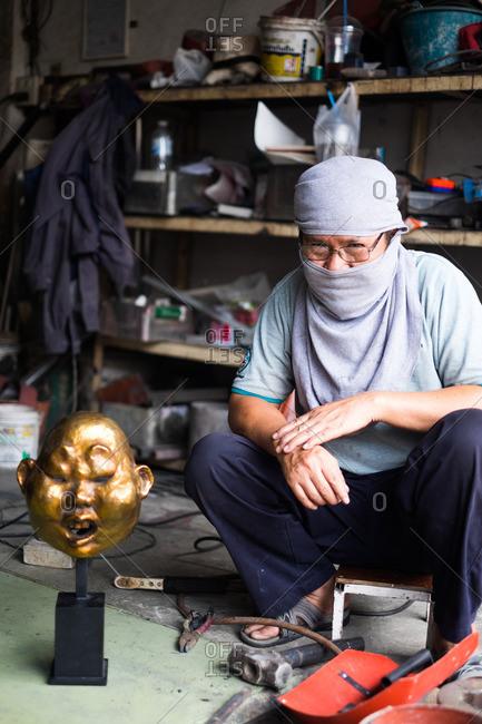 December 15, 2015: Artisan creating a gold sculpture