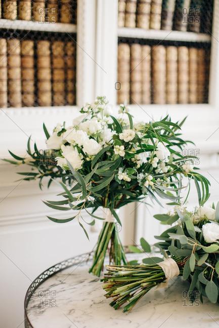 White flower arrangements on table