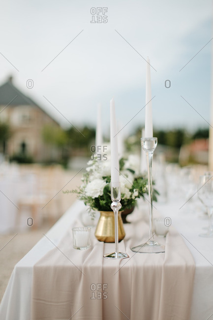 Candles on outdoor wedding table