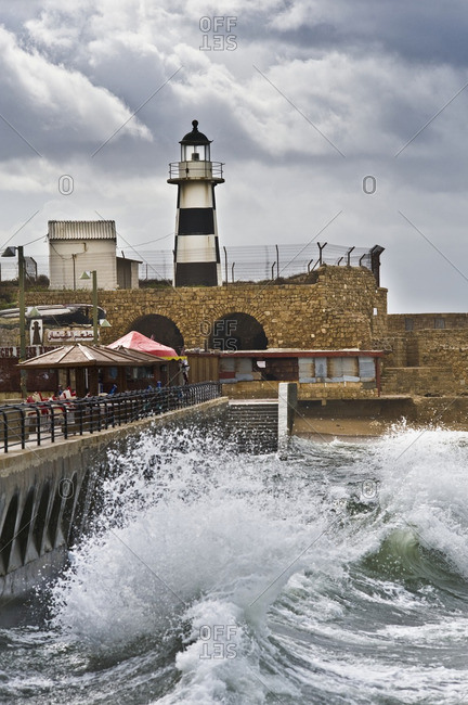 Acre, Israel - February 2, 2010: Fenced-in lighthouse in Acre