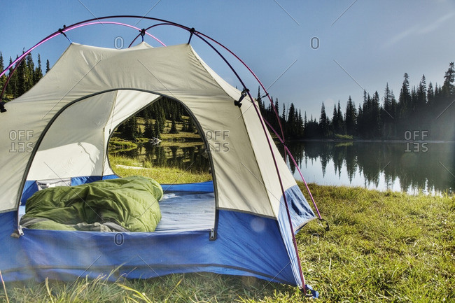 Tent at tranquil lakeside
