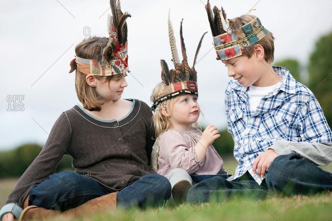 Children in Native American headgear