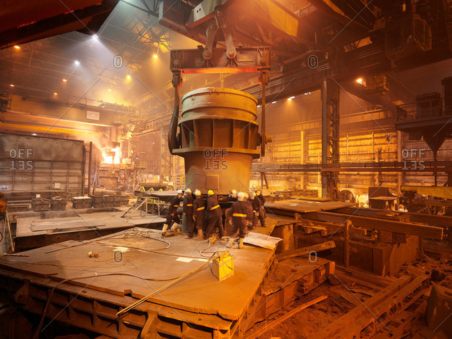 Workers In Steel Plant With Ladle