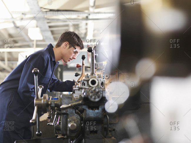 Apprentice Working With Basic Lathe