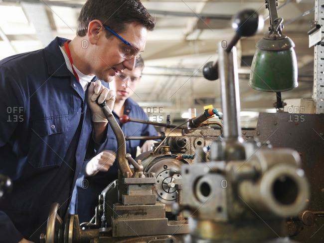 Experienced Engineer Teaching Apprentice