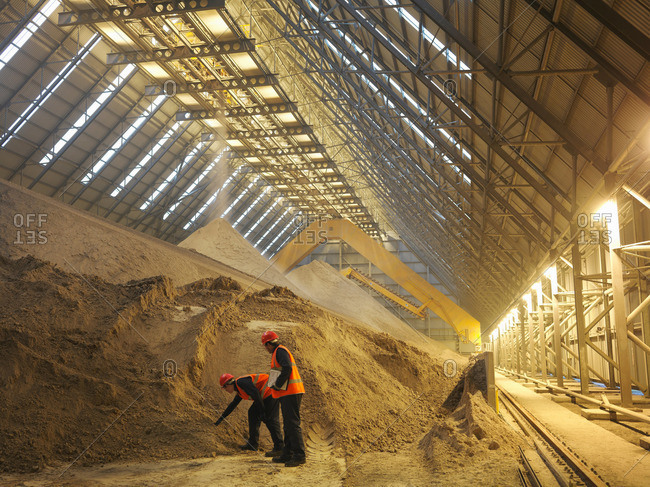 Workers Inspecting Gypsum Store - Offset
