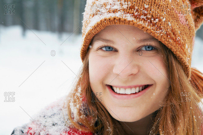 Smiling young woman in snow