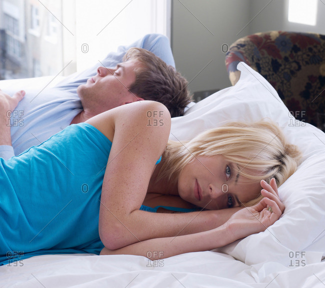 Couple lying down on bed