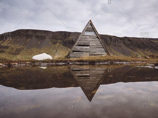 Triangular building on the edge of Lake Medalfellsvatn in Hvalfjordur, Iceland