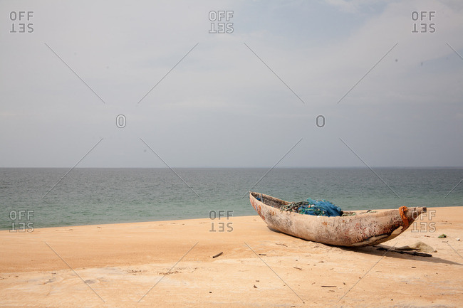Wooden boat with fishing nets on a beach