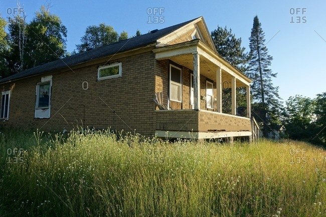 Old house in a field of tall grass