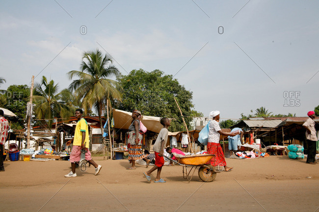 Monrovia, Liberia - February 14, 2008: People walking along a dirt street