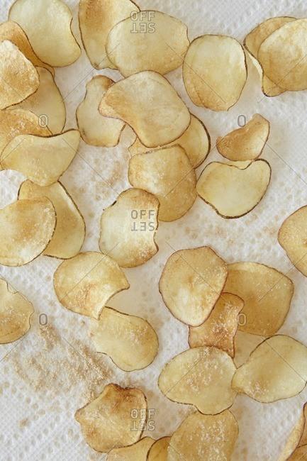 Homemade salt and vinegar potato chips on paper towel