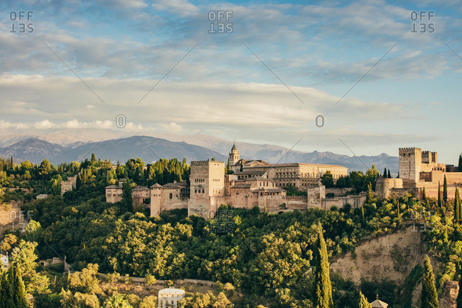 Alhambra Castle and mountains at sunset in Granada, Spain