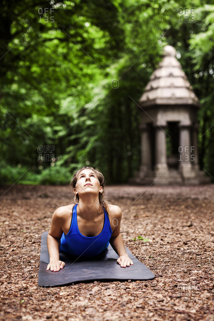Determined young woman practicing yoga at park
