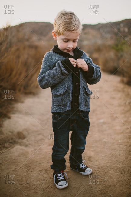Boy walking on trail