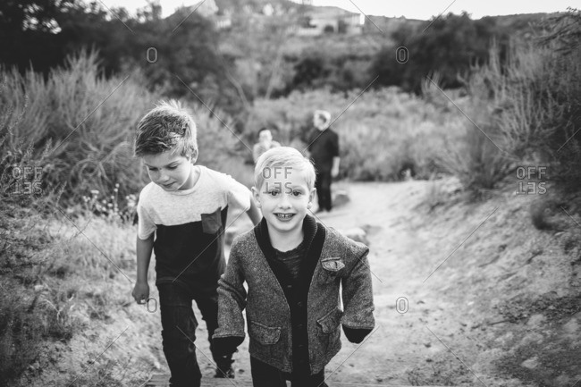 Boys walking on trail