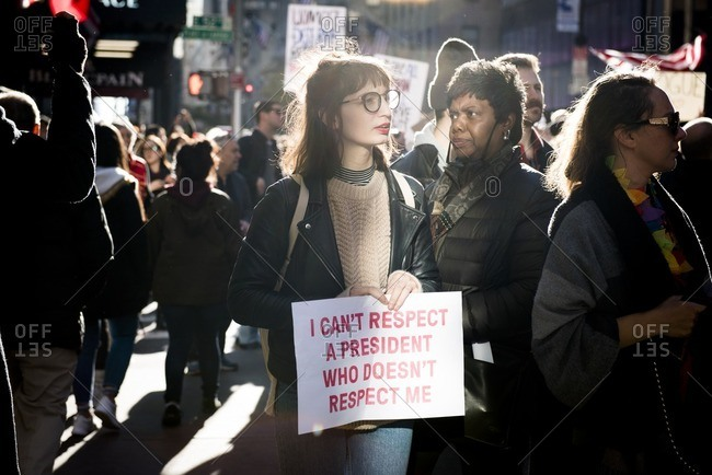 "New York City, New York - November 12, 2016: Woman holding sign that reads: ""I can't respect a president who doesn't respect me"" at an anti-Trump rally in New York City"