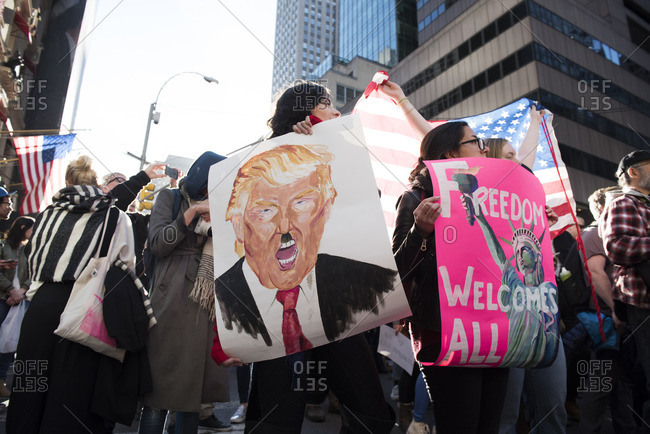New York City, New York - November 12, 2016: Protesters holding signs at an anti-Trump rally in New York City