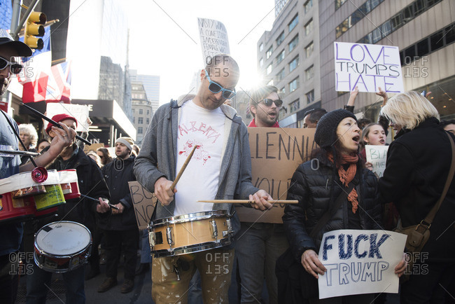 New York City, New York - November 12, 2016: Protesters holding signs and playing drums at an anti-Trump rally in New York City