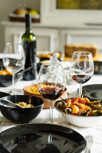 Wine glass on dining table prepared for family dinner