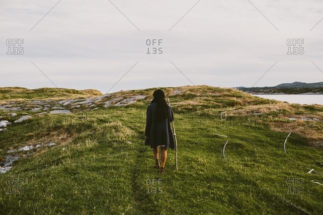 Woman walking in Norwegian fjords