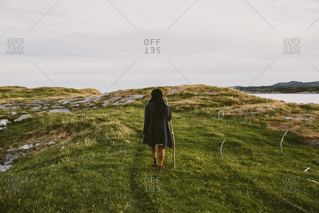Woman walking in Norwegian fjords