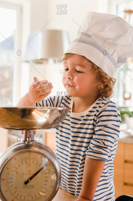 Young Boy Playing With Flour