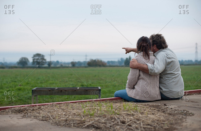 Couple Watching Sunrise Over Fields