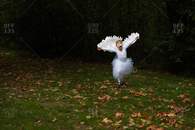 Girl dancing in bird costume