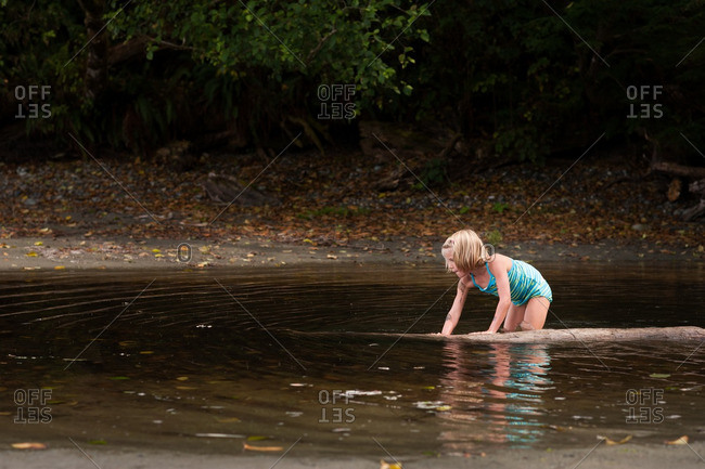 Girl playing in summer water
