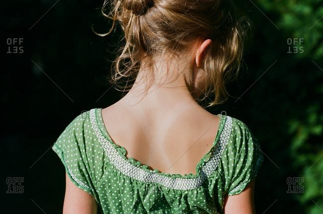 Back of girl in green dress