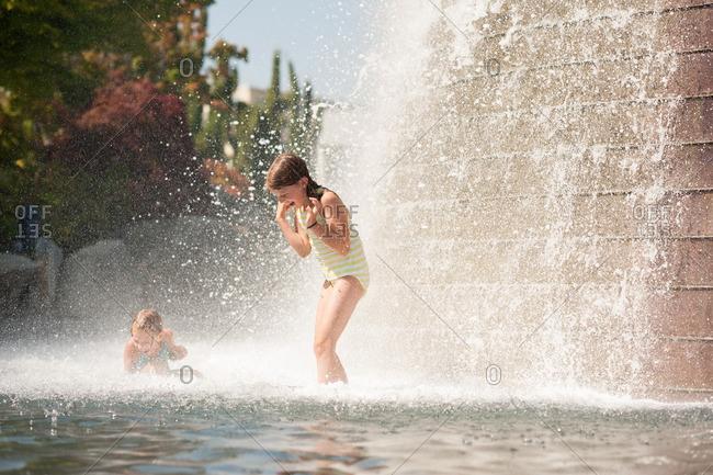 Girls having fun in fountain water