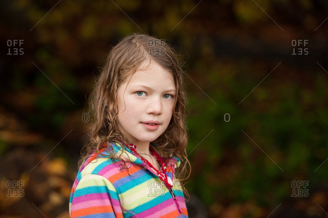 Girl with green eyes in striped shirt
