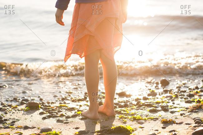 Bare feet of child on beach