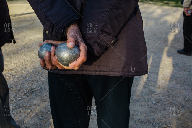 Bocce balls in person's hands