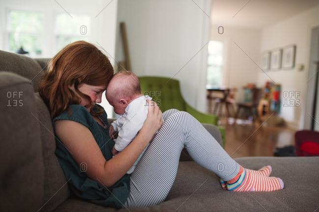 Girl holding newborn in lap