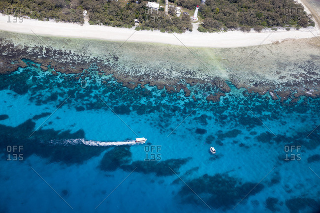 Boats floating over the coral gardens of Lady Elliot Island, a coral cay located at the southern tip of the World Heritage Listed Great Barrier Reef