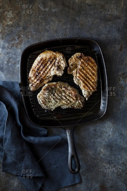 Cooked pork loin steaks
