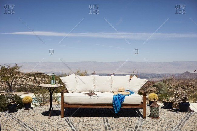 Couch on patio with mountain view