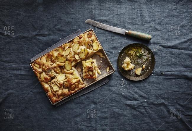 Rosemary potato focaccia in baking tray