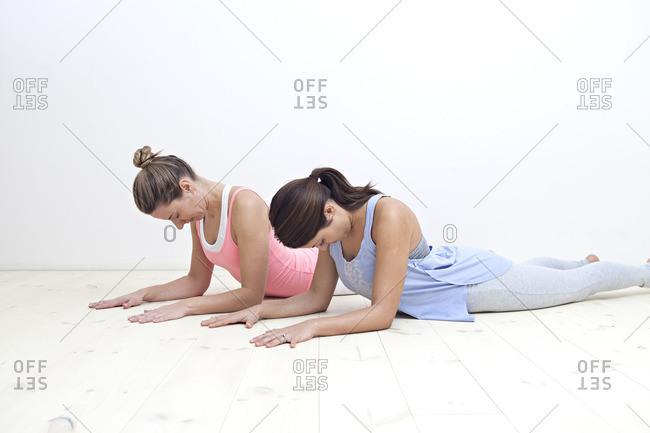 Girls in sphinx yoga posture