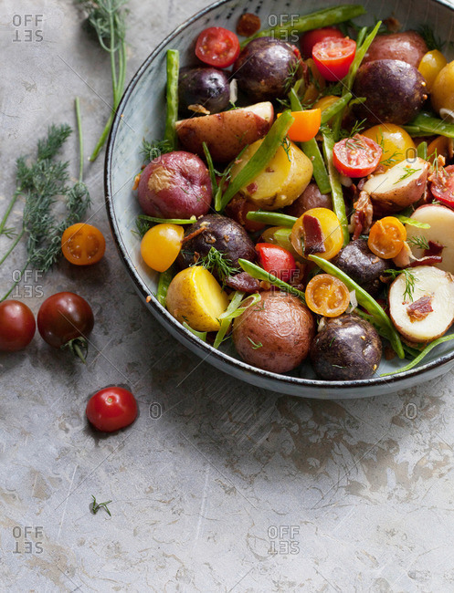 Vegetables in a pan with bacon and potatoes