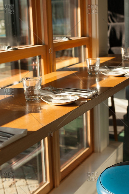 Table settings on a restaurant table by a window