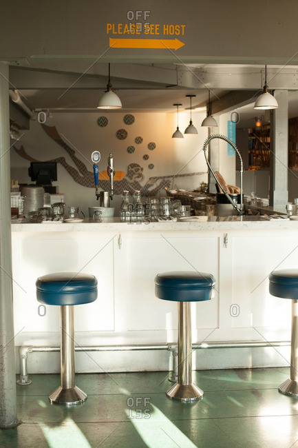 November 22, 2015: Interior of restaurant with blue barstools and scuba diver image on wall