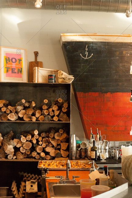Seattle, Washington - November 22, 2015: Interior of restaurant with ship d�cor and logs on a shelf