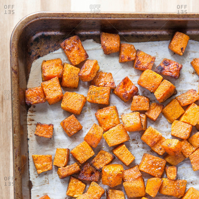 Roasted butternut squash on a baking pan