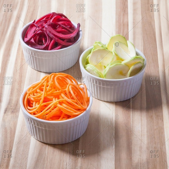 Spiralized vegetables in white bowls