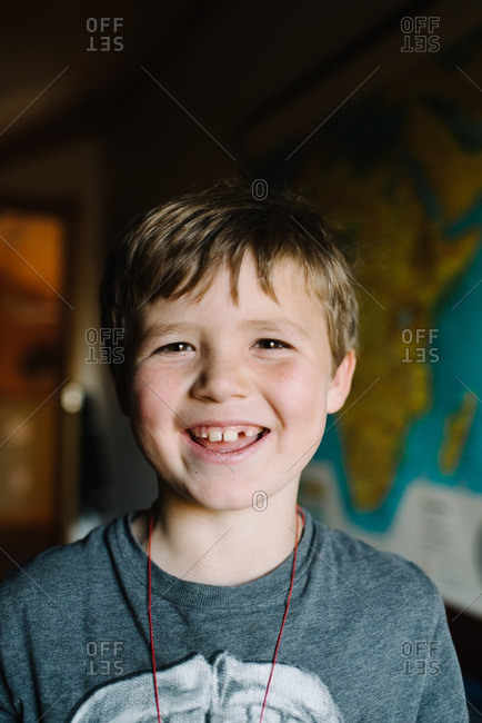 Portrait of a smiling boy with brown eyes