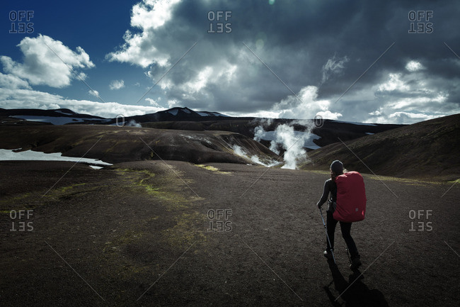 Woman walking on a hiking trail in Iceland